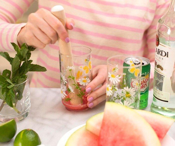 Muddling the watermelon for Watermelon Mojito Cocktail