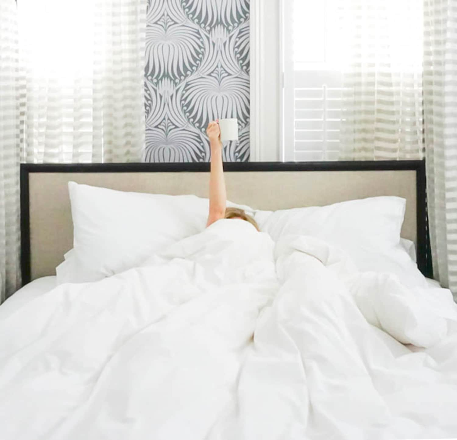 Ashley Brooke of Ashley Brooke Designs has coffee in bed at 86 Cannon in Charleston, SC