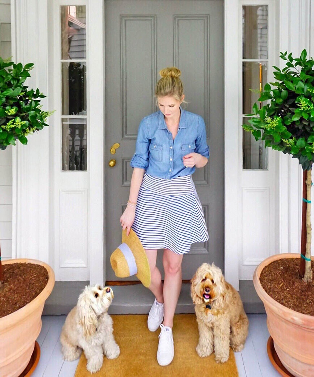 Ashley Brooke of Ashley Brooke Designs is greeted by pups Gus and Sully at 86 Cannon in Charleston, SC