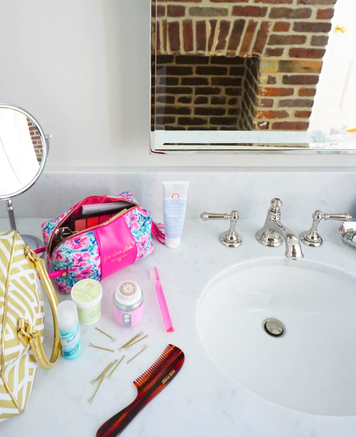At look at Ashley Brooke's marble bathroom at 86 Cannon in Charleston, SC