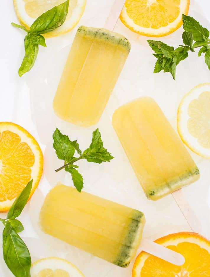 Basil Mint Citrus Mojito Popsicles would be perfect to bring to a Memorial Day party! | www.ashleybrookedesigns.com