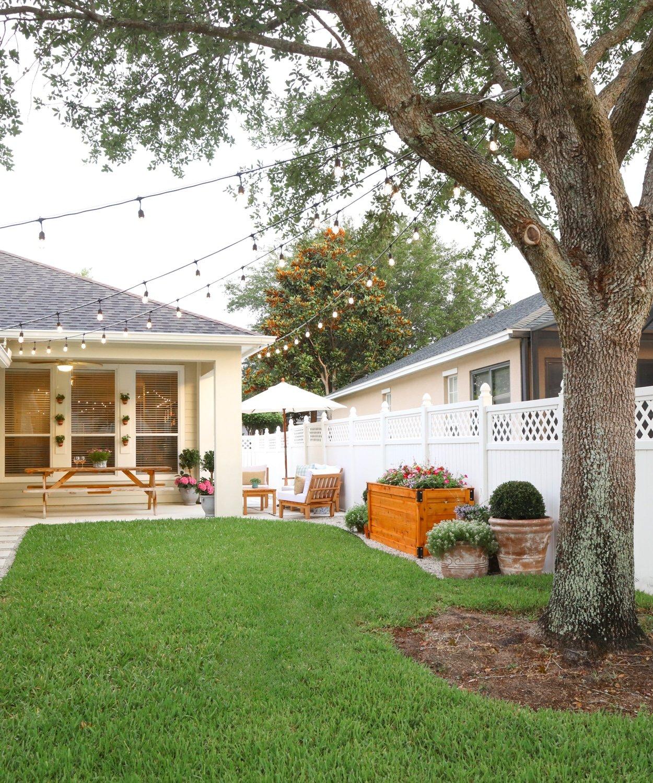 Blogger Ashley Brooke's husband, Ryan, shares how to hang DIY string lights in your backyard! | www.ashleybrookdesigns.com