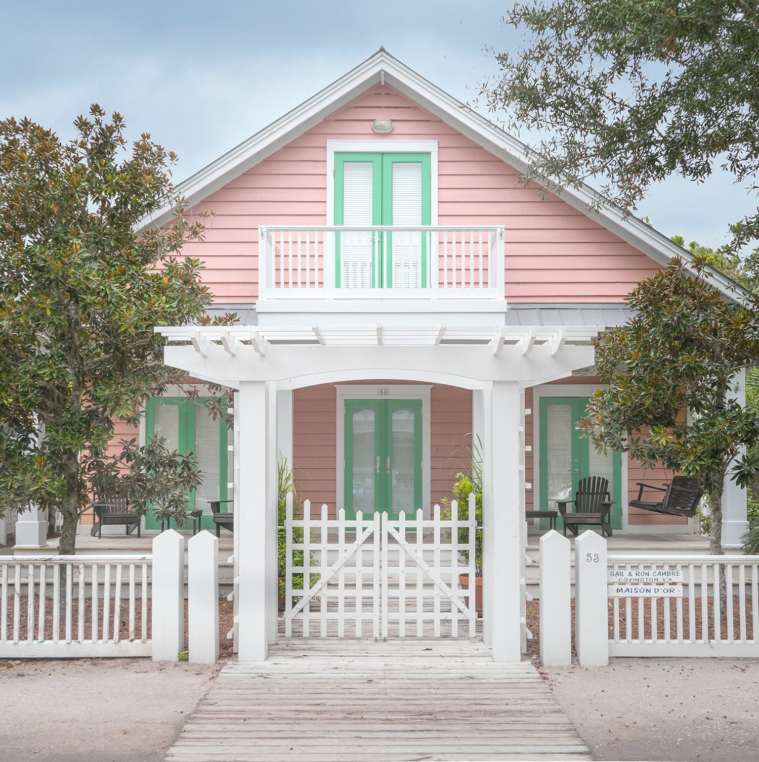 Ashley Brooke Designs Loves this pretty pink home in Watercolor, FL