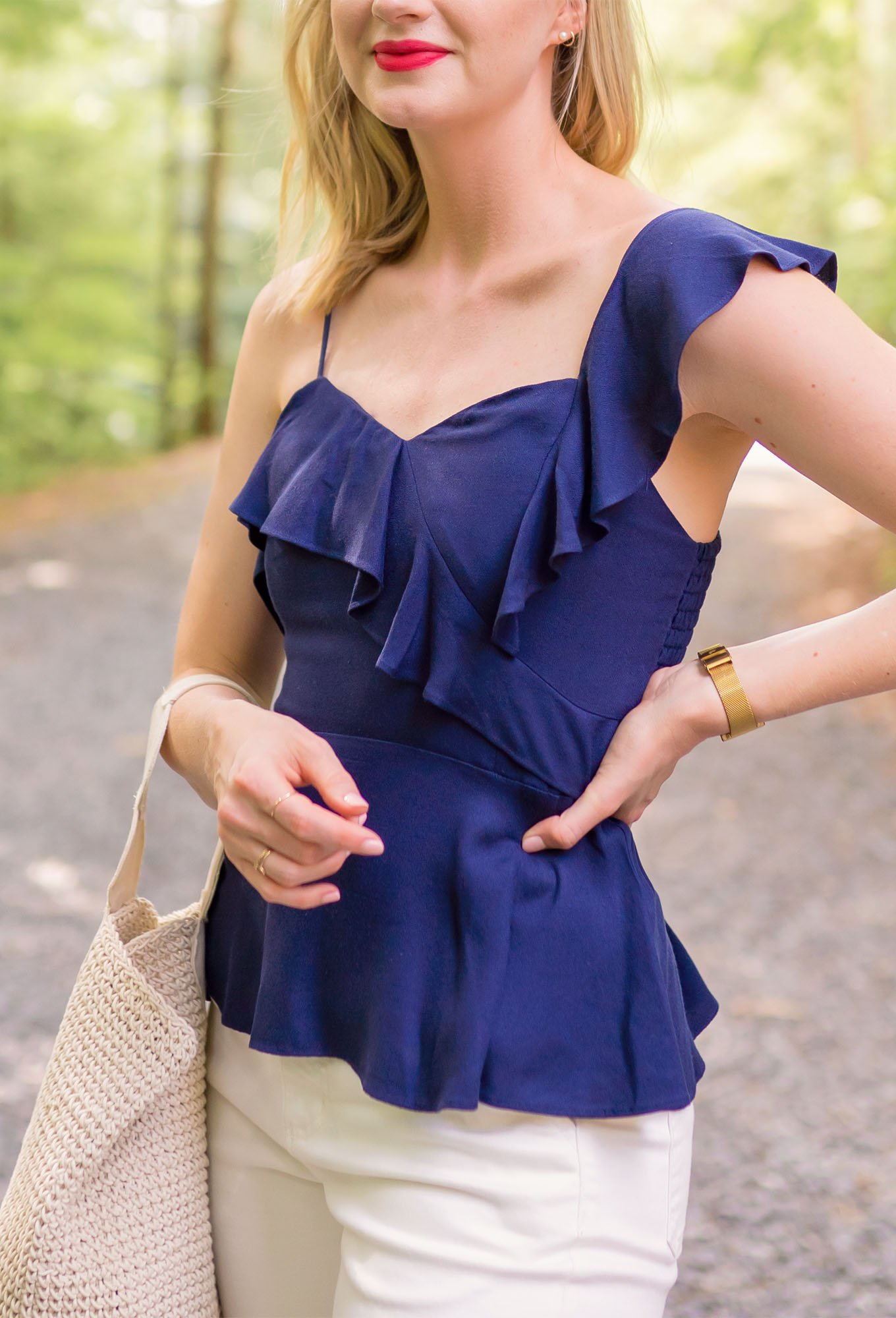 Close up of Ashley Brooke outfit in white cropped pants and navy peplum top on www.ashleybrookedesigns.com