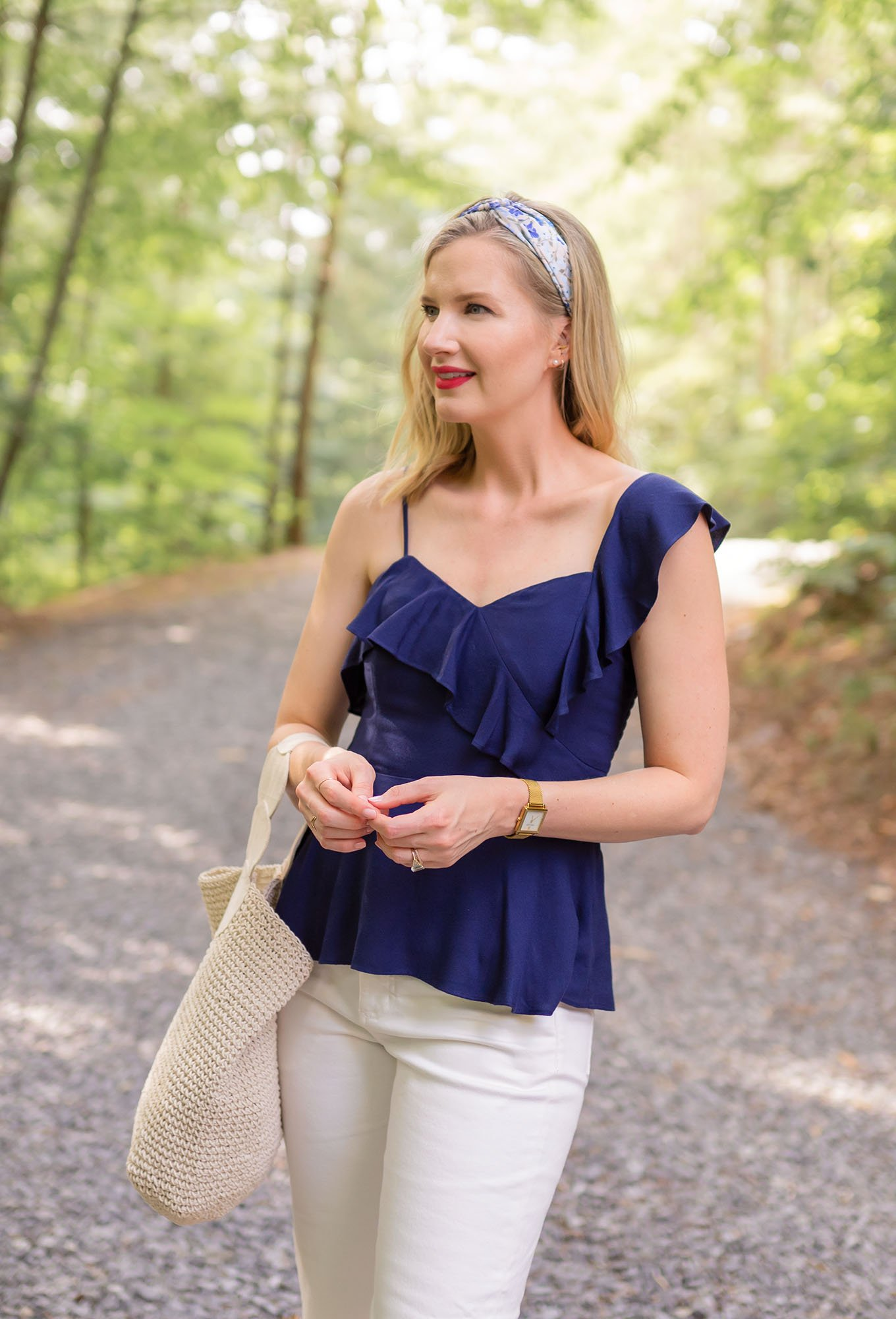Ashley Brooke outfit in white cropped pants and navy peplum top on www.ashleybrookedesigns.com