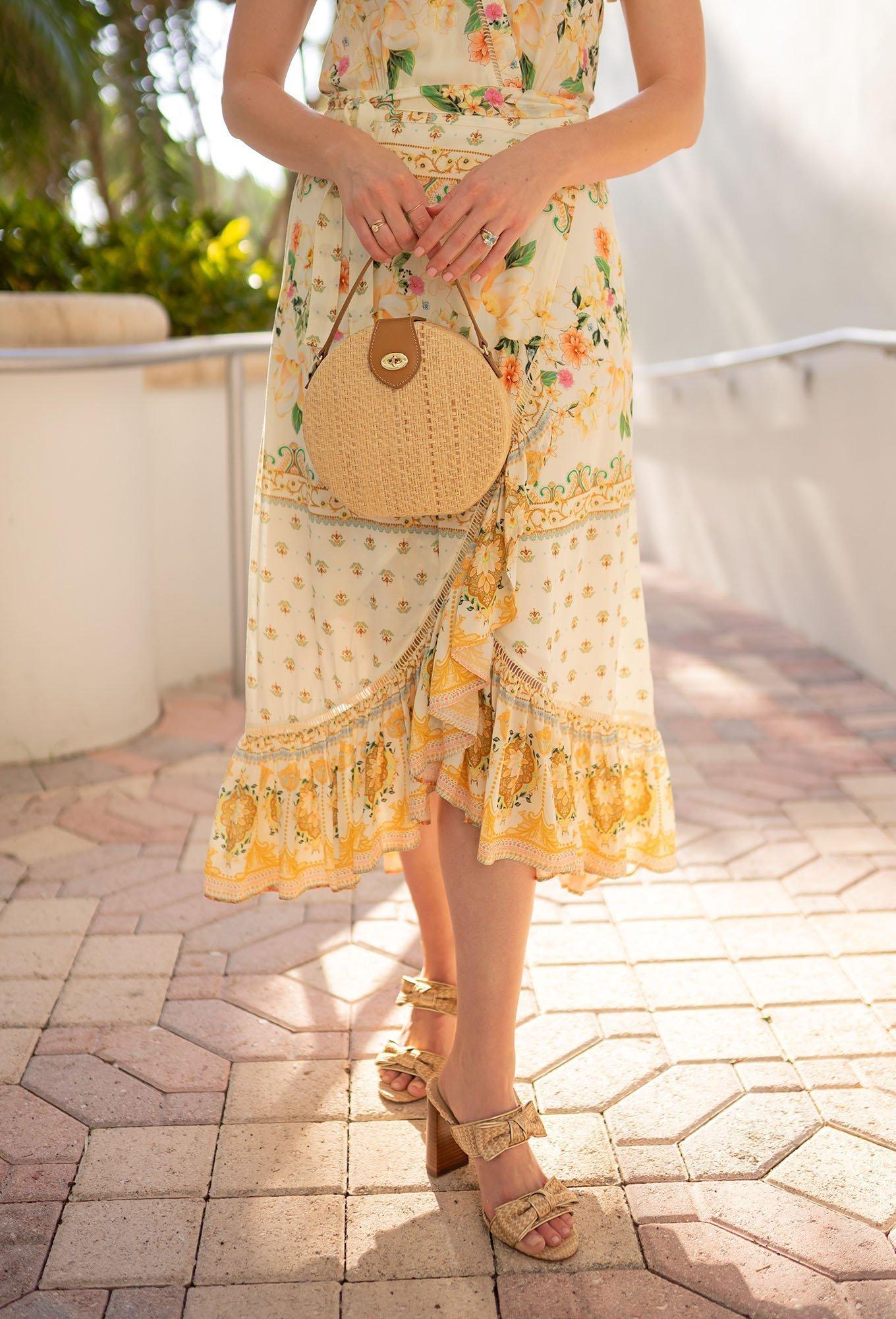 Ashley Brooke holding J.McLaughlin handbag on Miami's South Beach