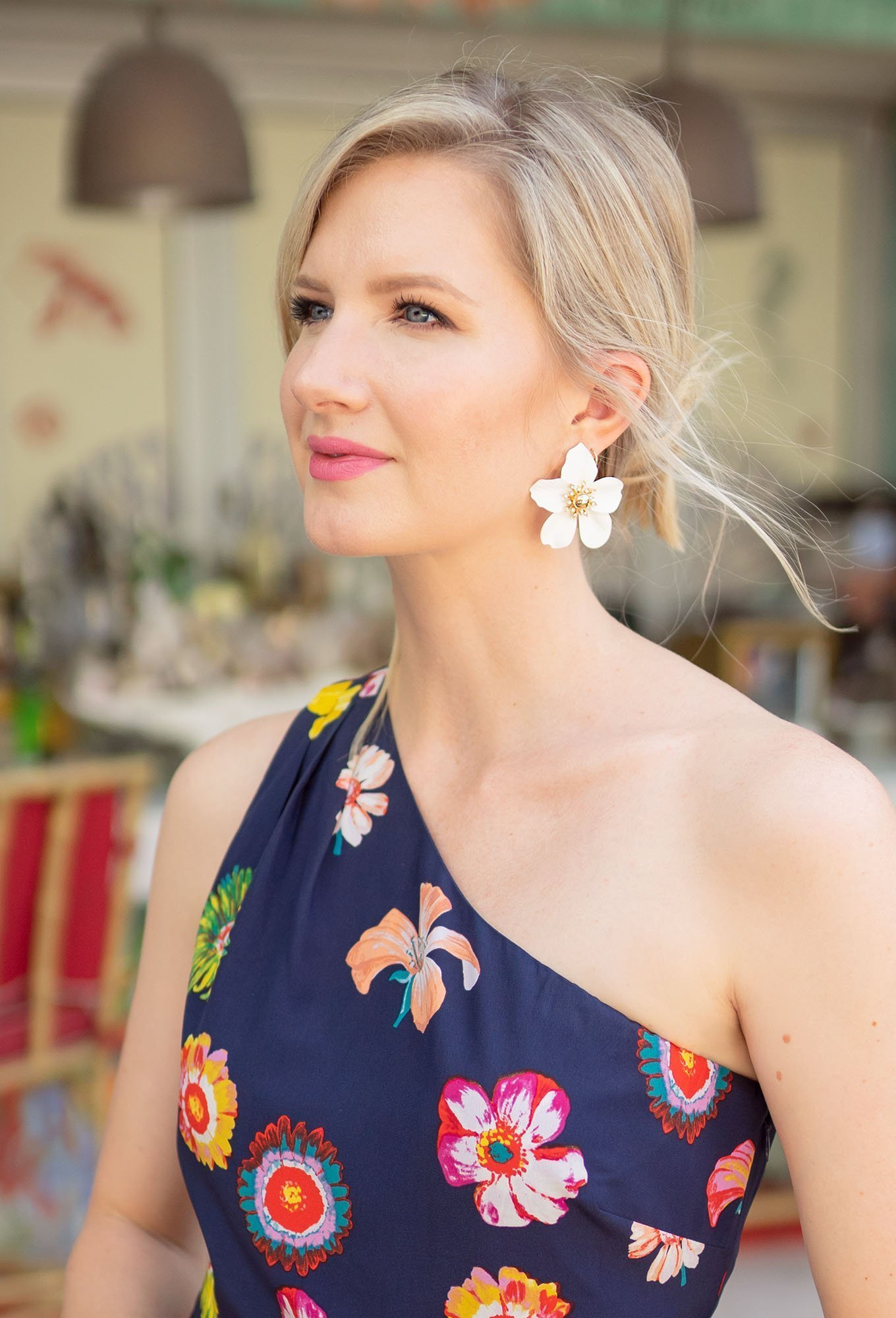 Ashley Brooke at the Faena Hotel in Miami wearing floral one shoulder dress
