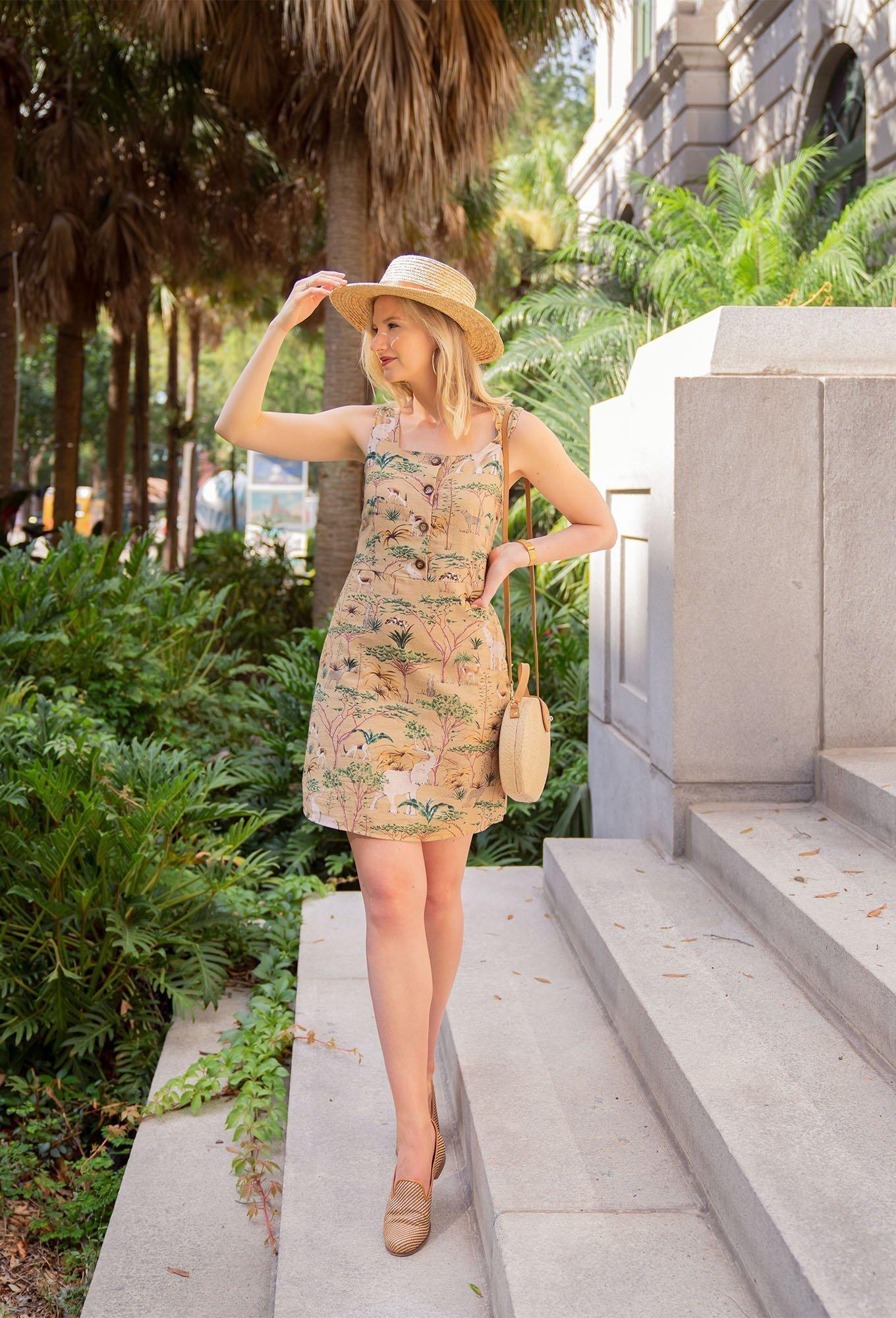 Ashley Brooke wearing Stubbs & Wootton, Mango Dress, and Straw Hat.