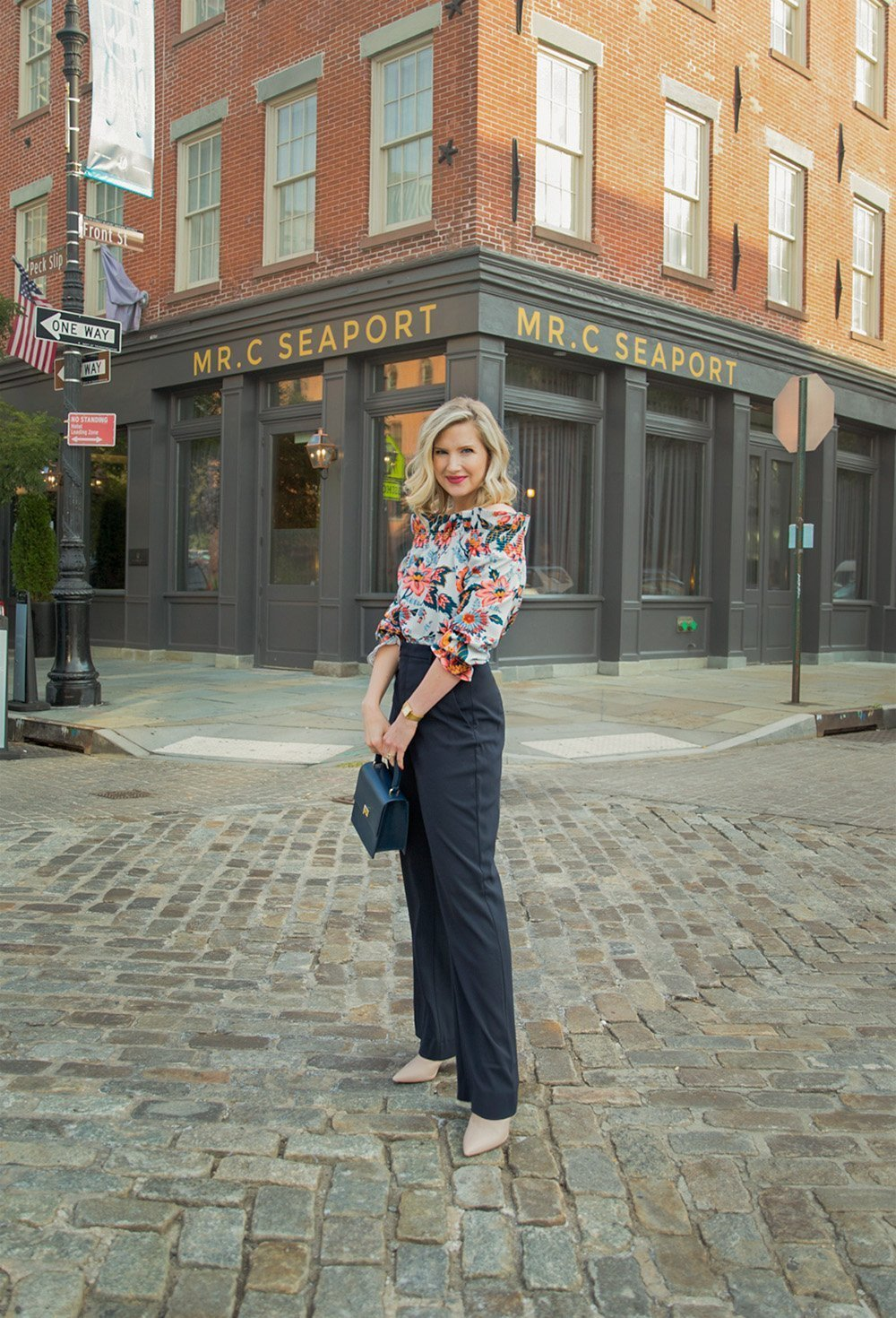 Fashion blogger Ashley Brooke in New York City wearing ruffle top and wide leg pants