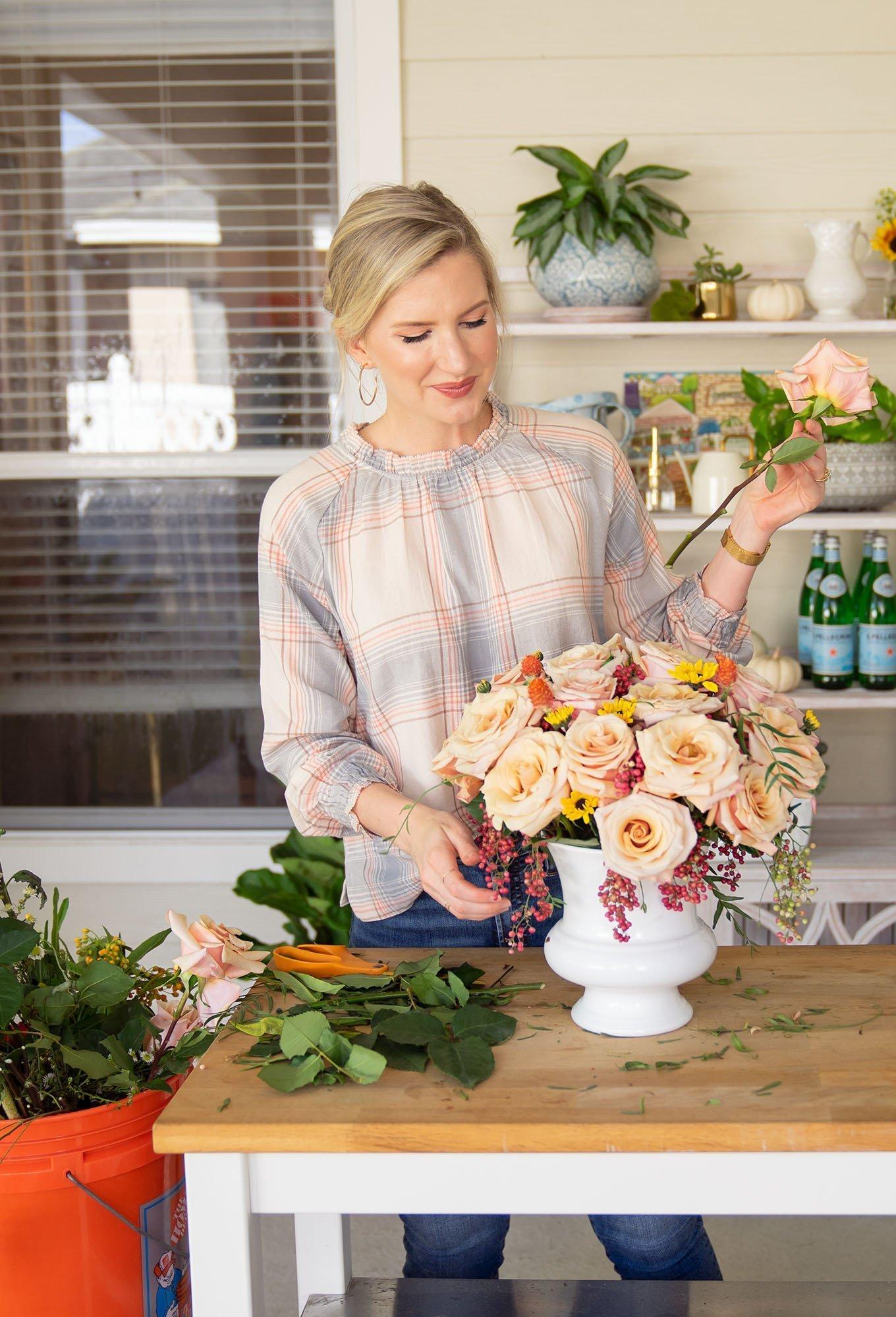 Ashley Brooke creating a Fall flower arrangement on her blog.