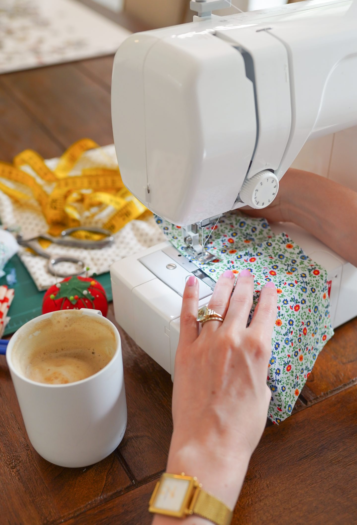Ashley Brooke sewing napkins on her sewing machine
