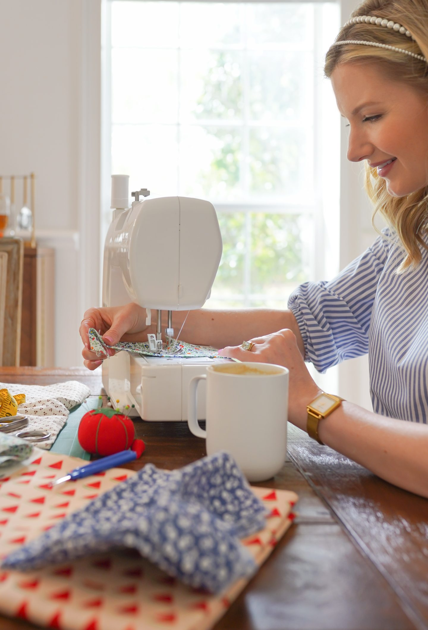 Ashley Brooke with her sewing machine
