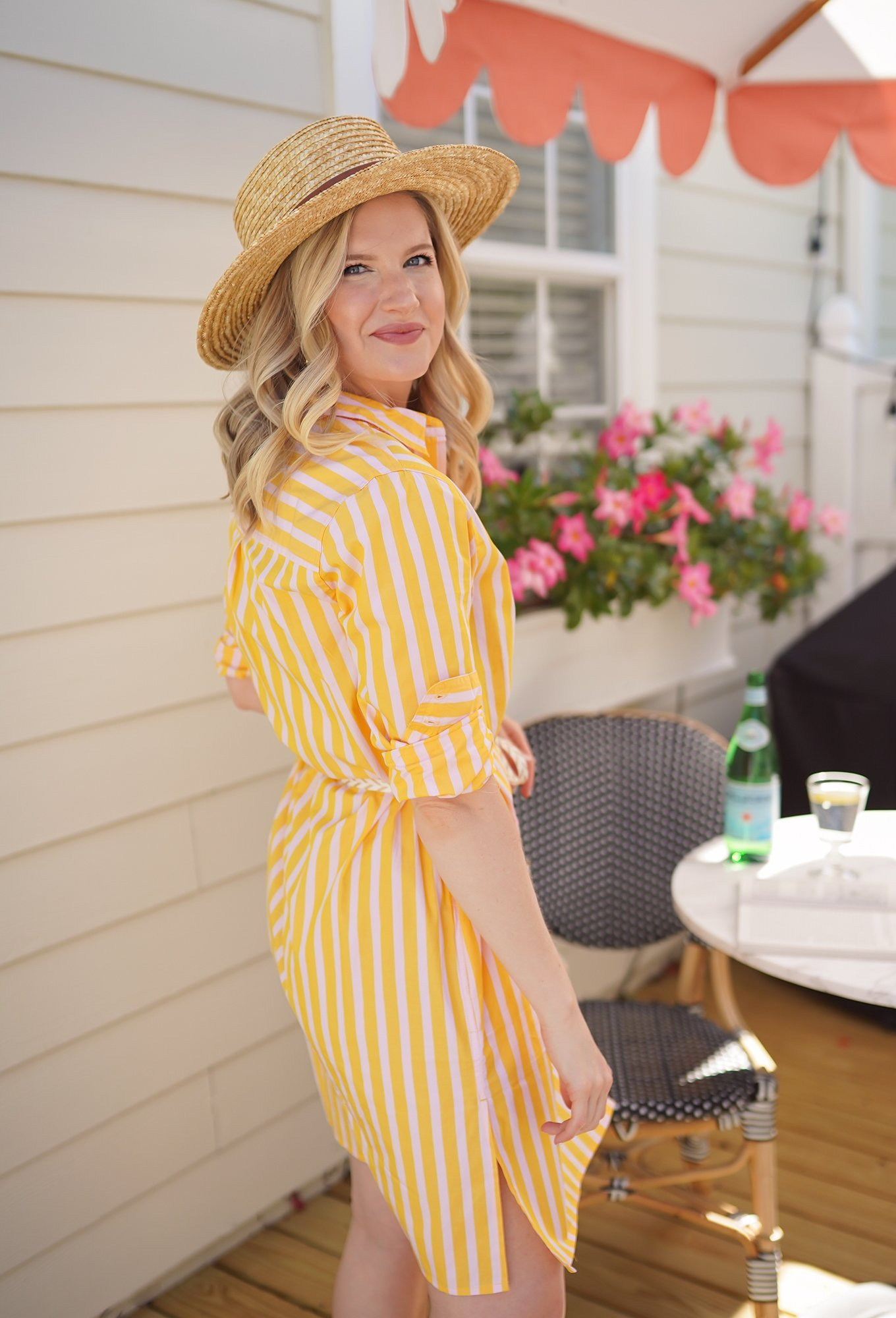 Ashley Brooke wearing a yellow striped dress from J Crew