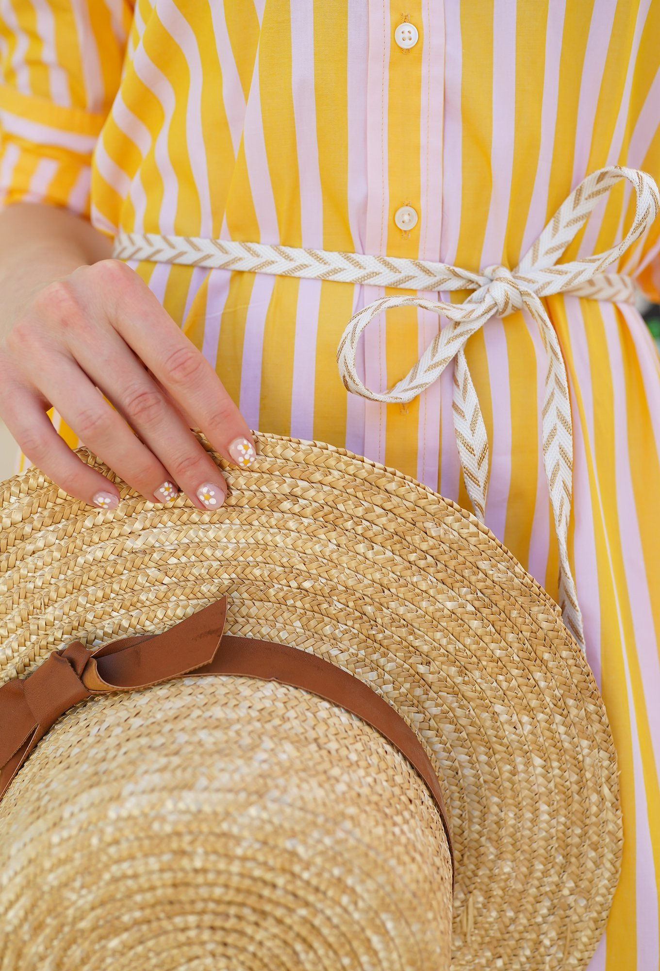 Ashley Brooke in yellow striped dress and straw hat
