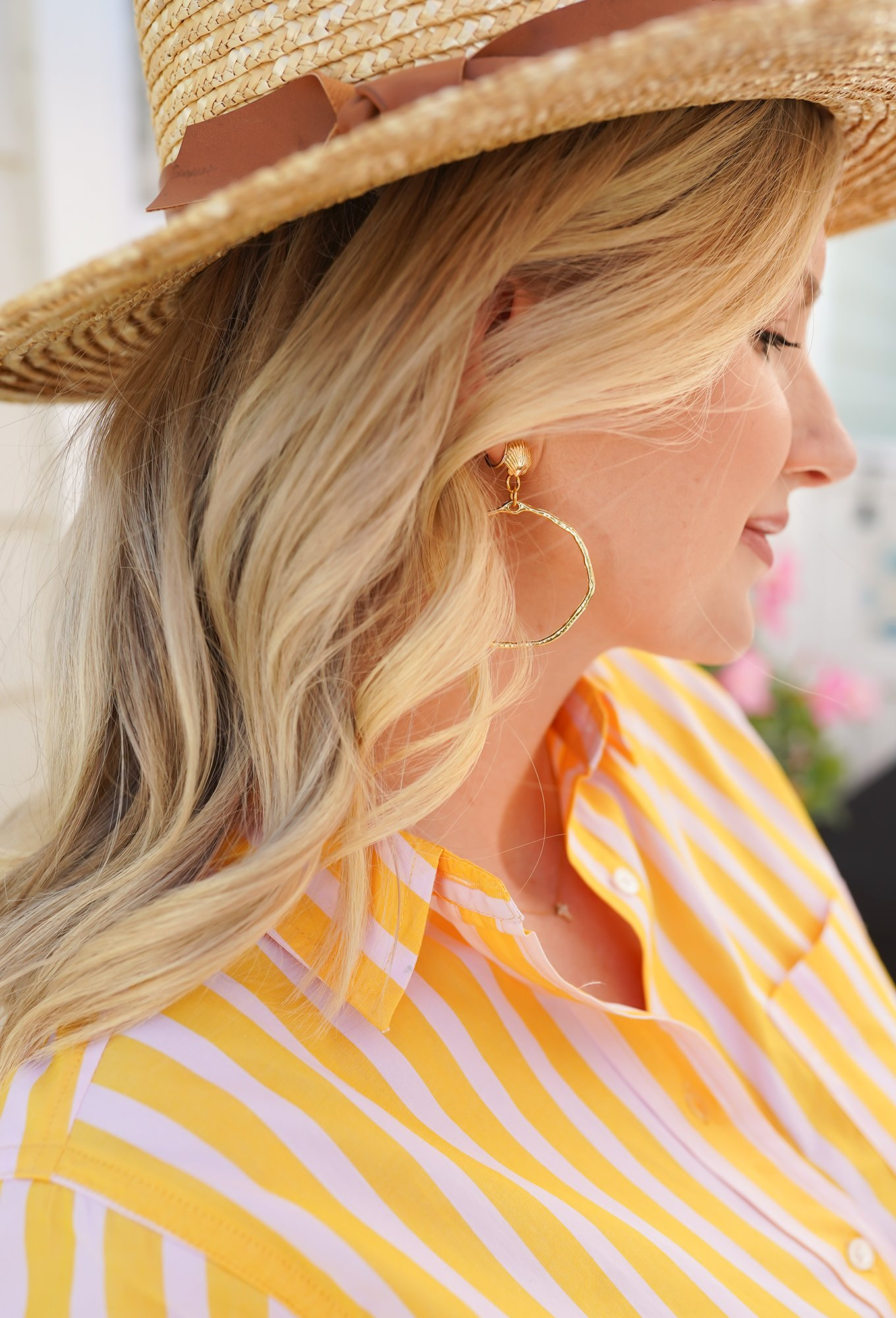 Ashley Brooke wearing straw hat with yellow striped dress