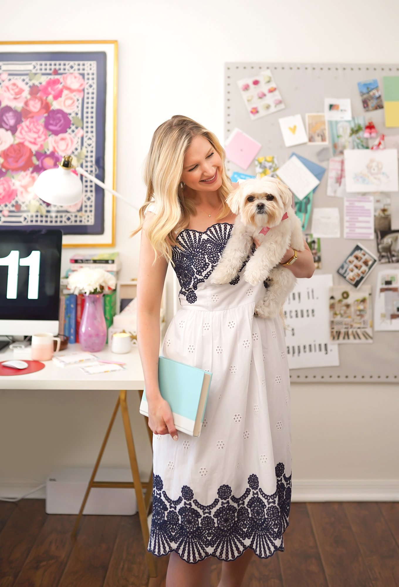 Ashley Brooke in her home office with pup Dolly