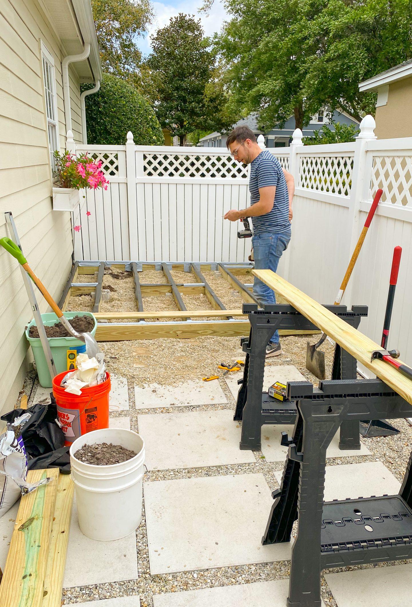 Ryan building wood deck on Ashley Brooke Designs