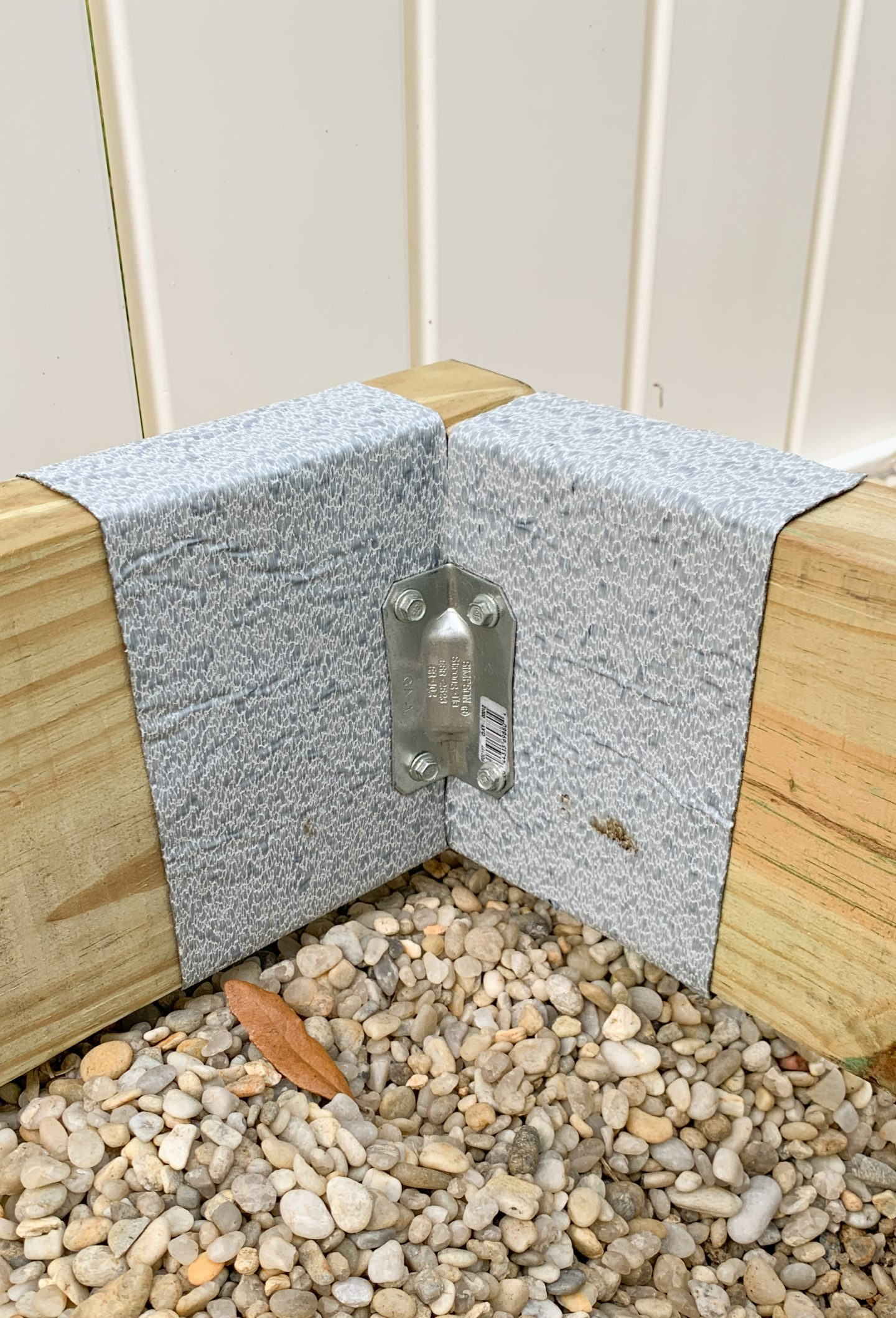 How to build a wood deck - installing corner brace