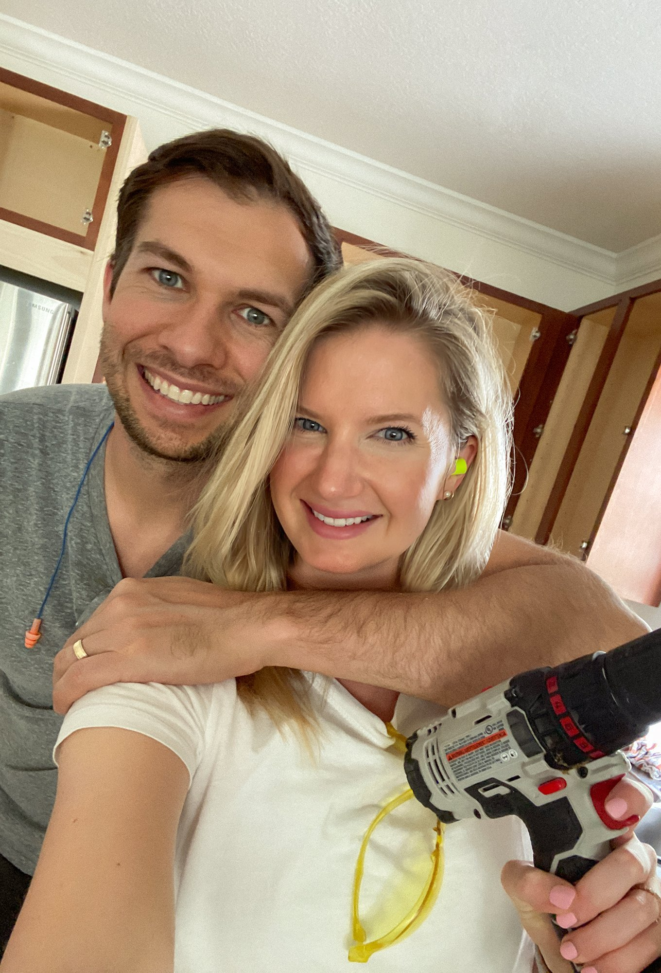 Ashley Brooke and Ryan in their DIY kitchen renovation