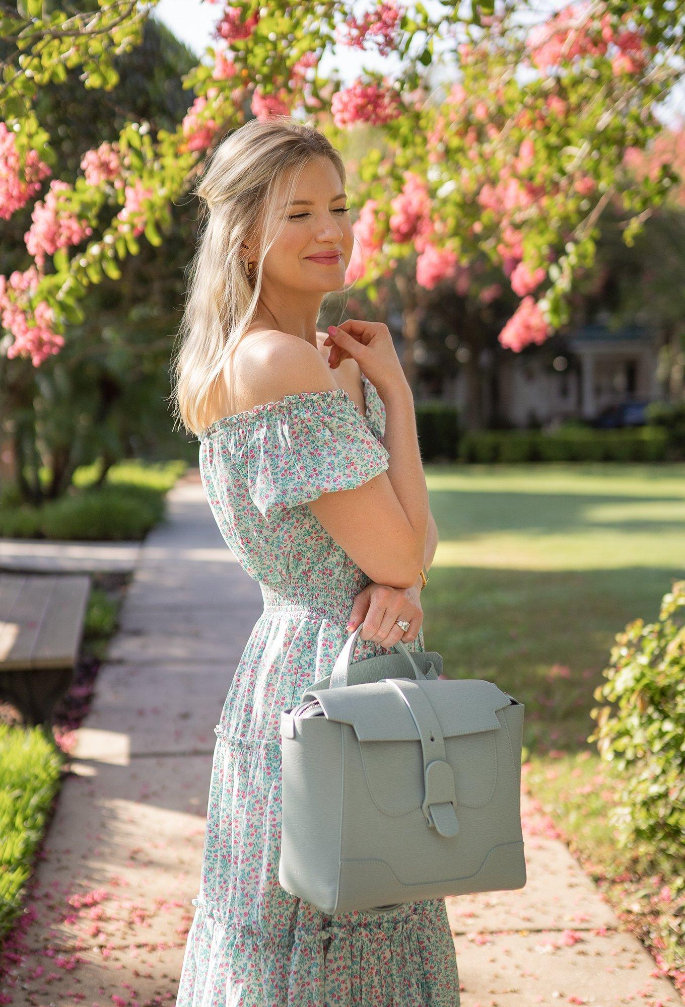 Ashley Brooke in floral smocked dress and Senvere handbag
