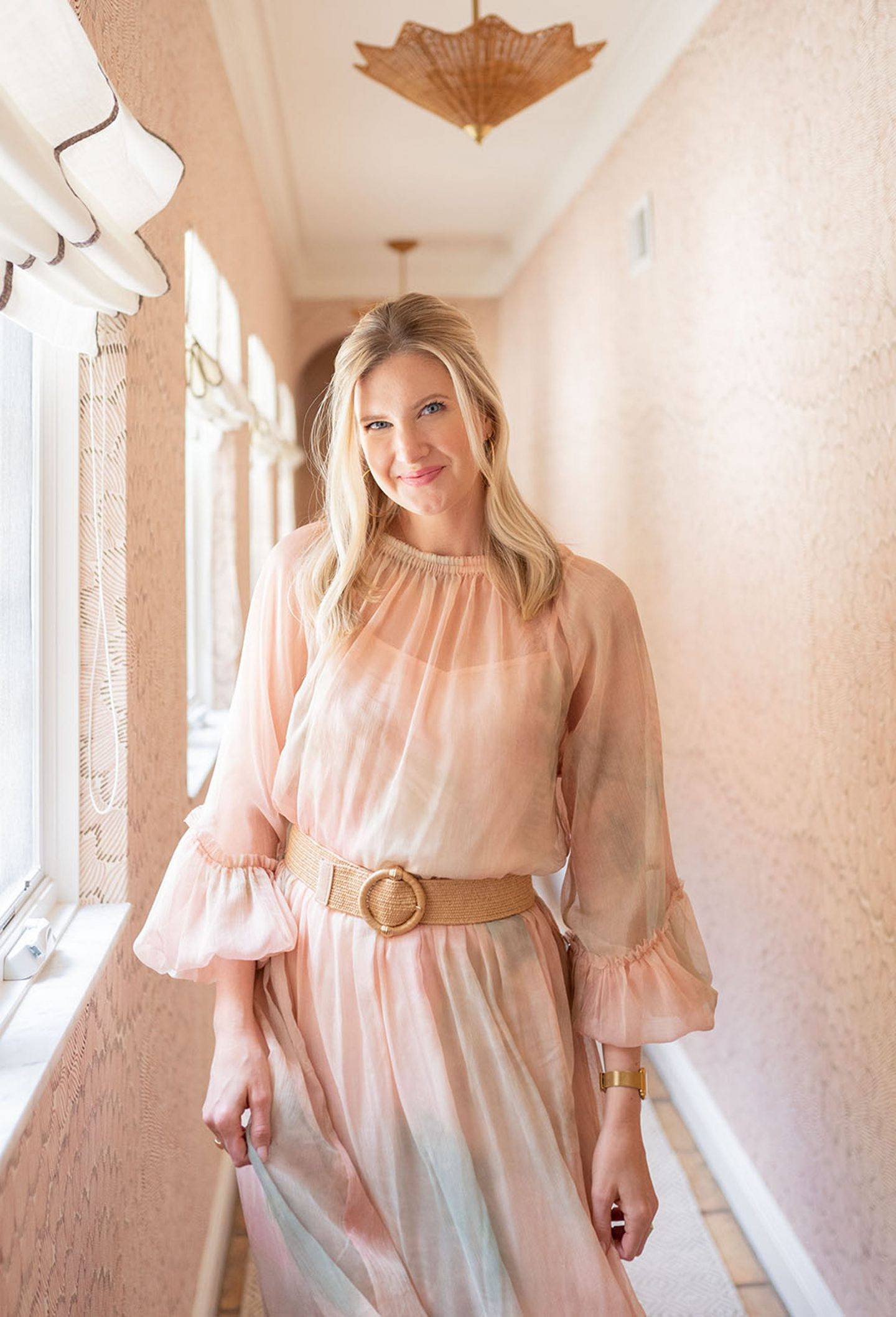 Ashley Brooke in pink hallway at The Colony Hotel in Palm Beach