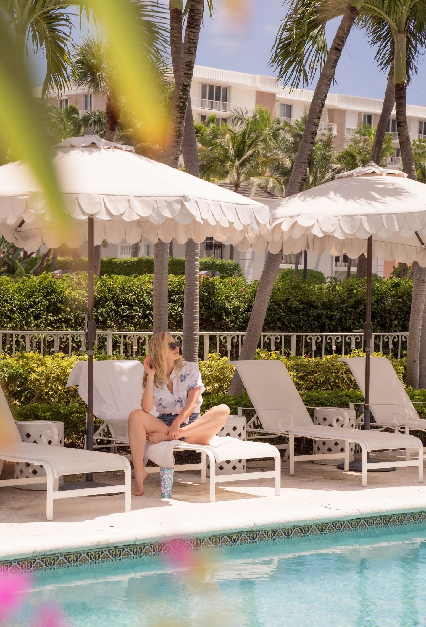 Ashley Brooke sitting by the villa pool at The Colony hotel.