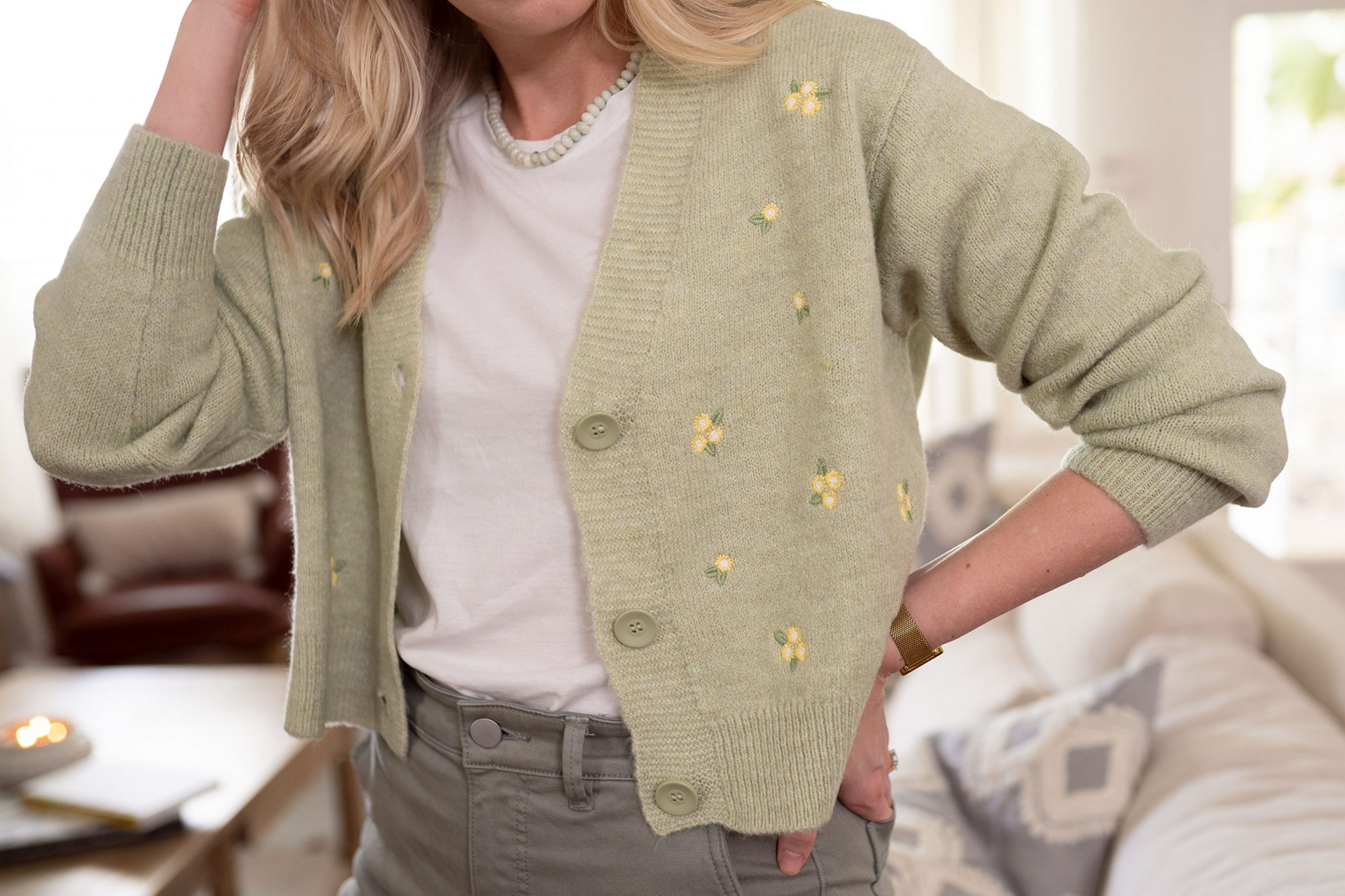 Ashley Brooke wearing this season's daisy floral cardigan sweater