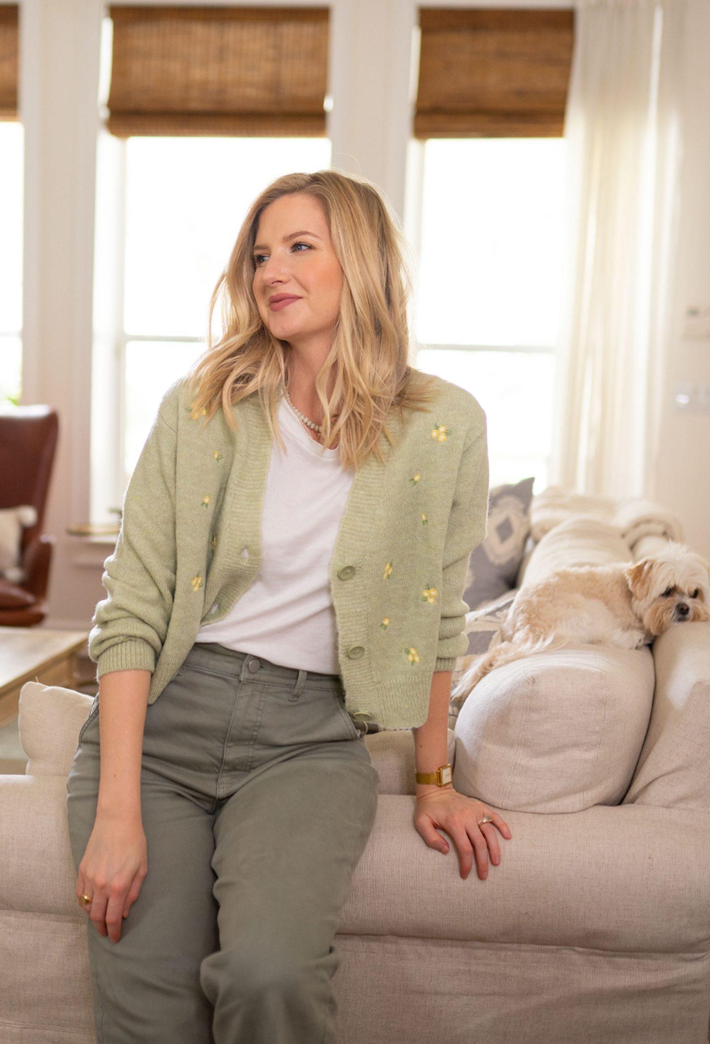 Ashley Brooke wearing a daisy floral cardigan sweater