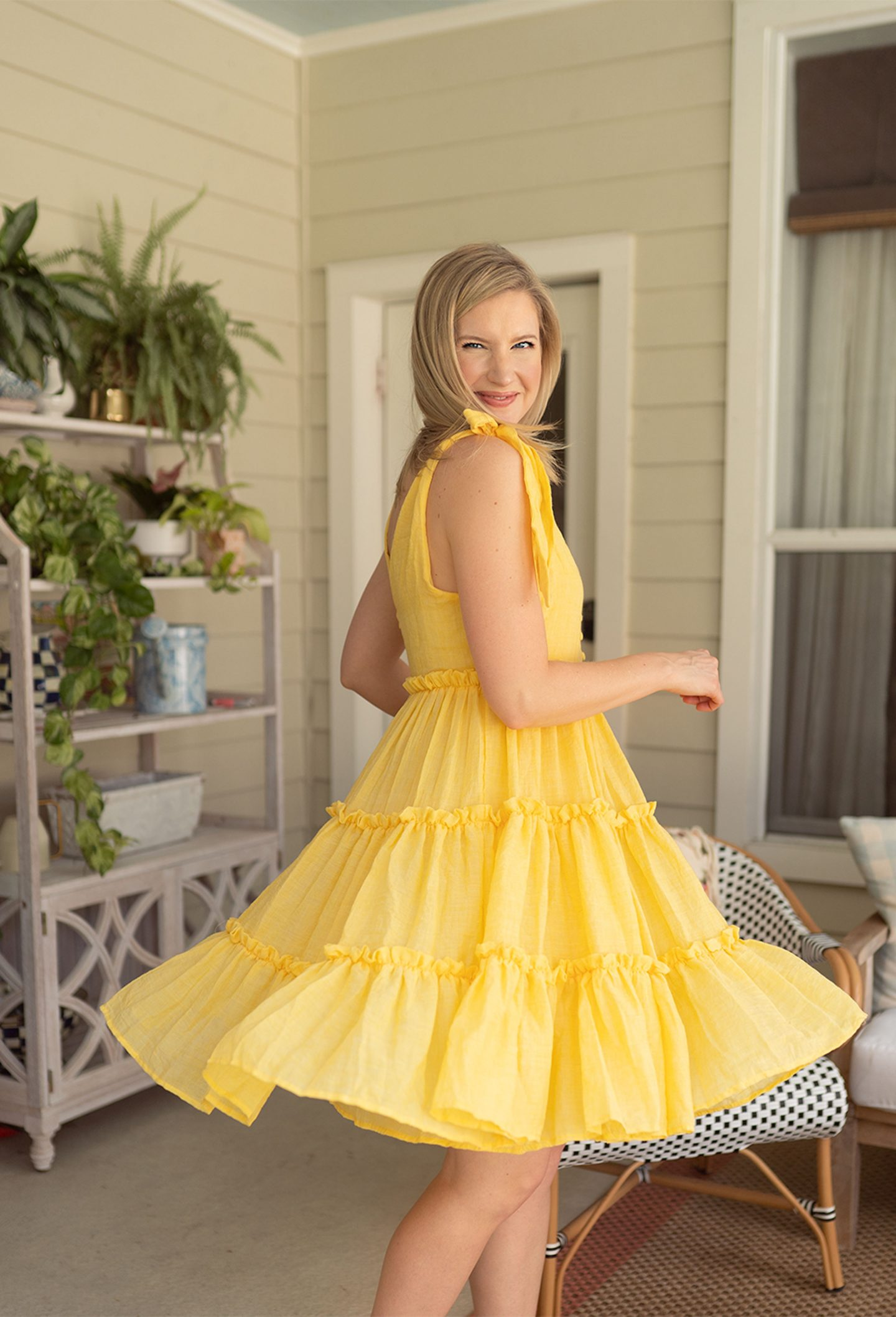 Ashley Brooke spins in a tie shoulder yellow mini dress from ShopBop