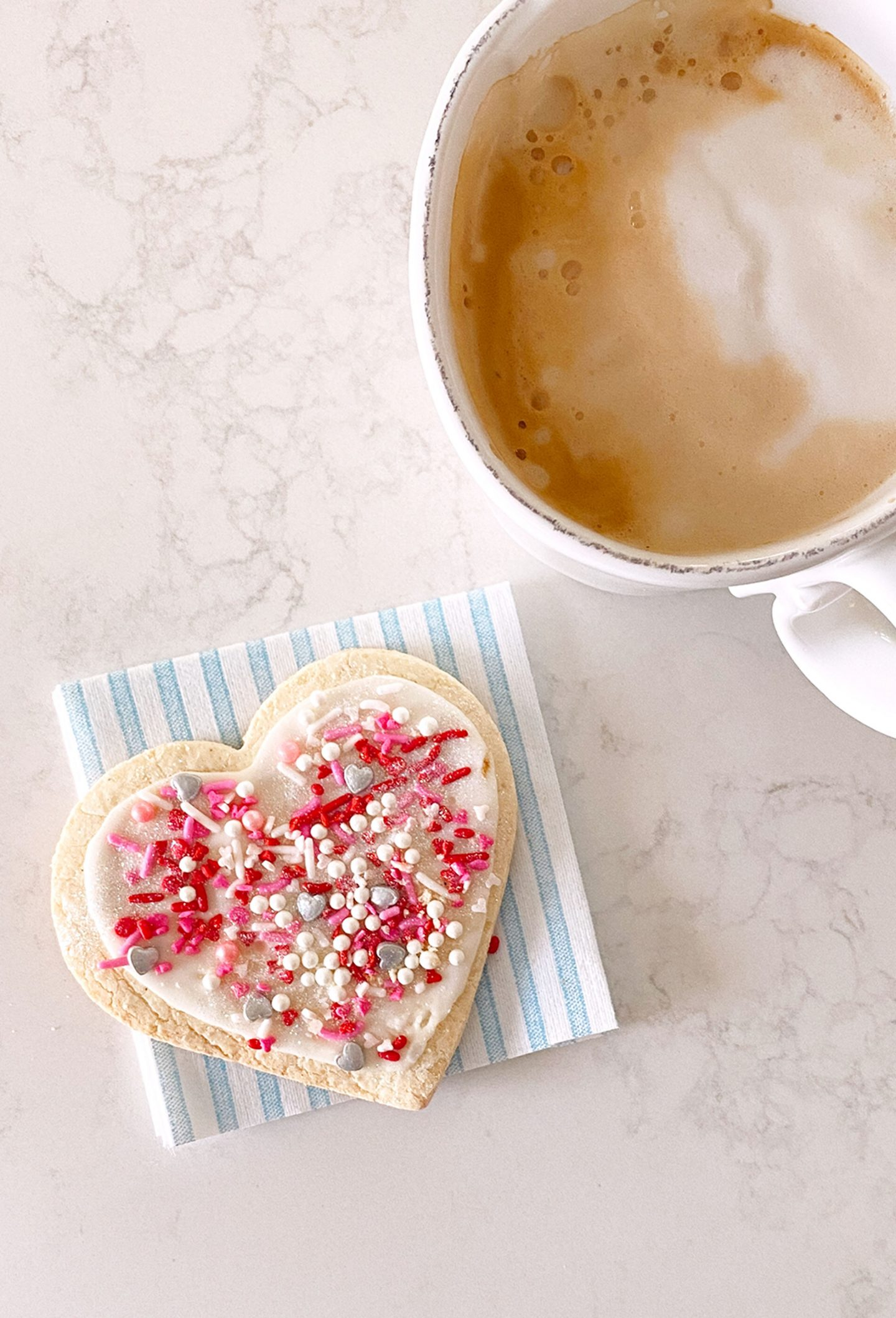 Heart shaped sugar cookie with sprinkles for Valentine's Day