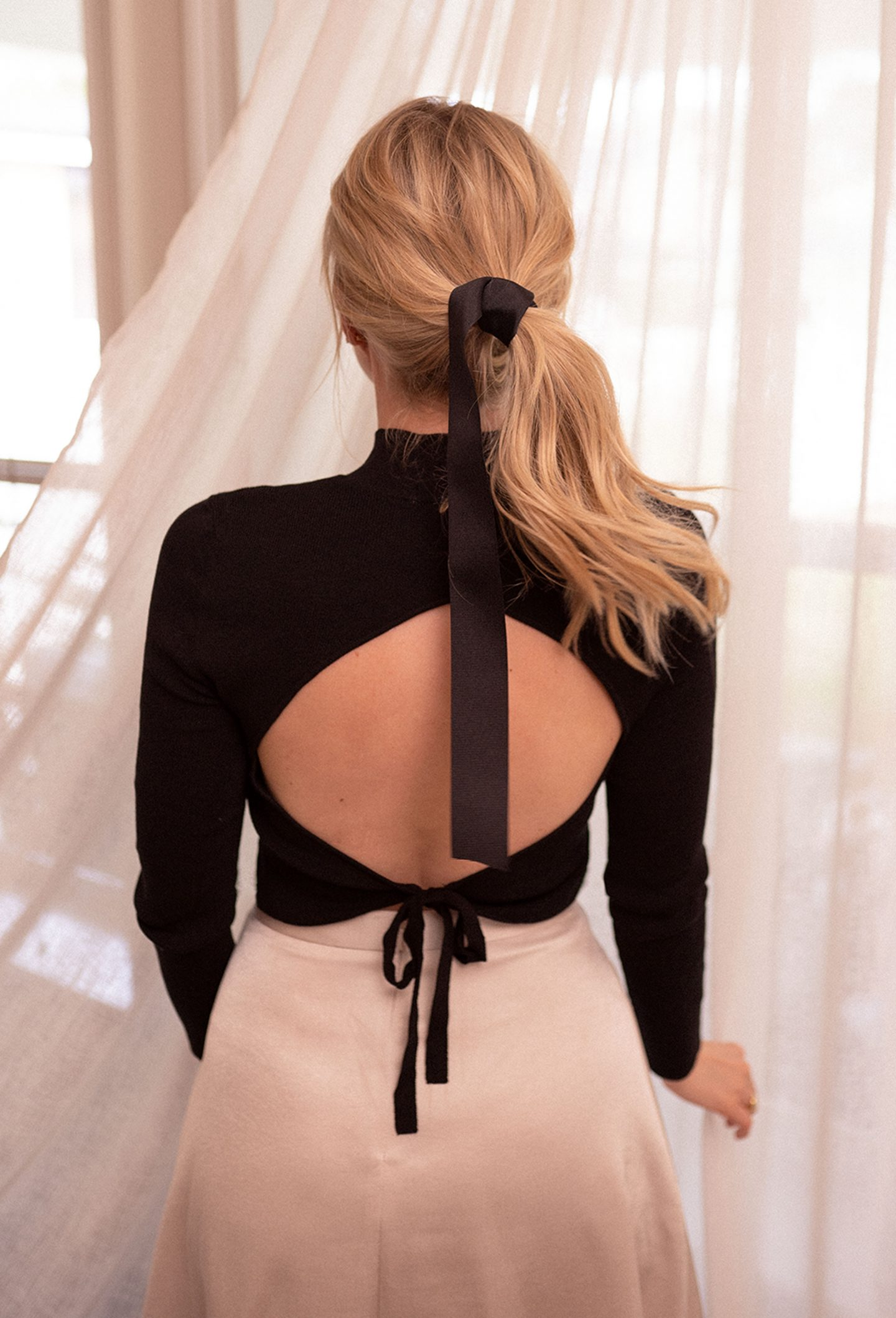 backless ballerina top worn by Ashley Brooke