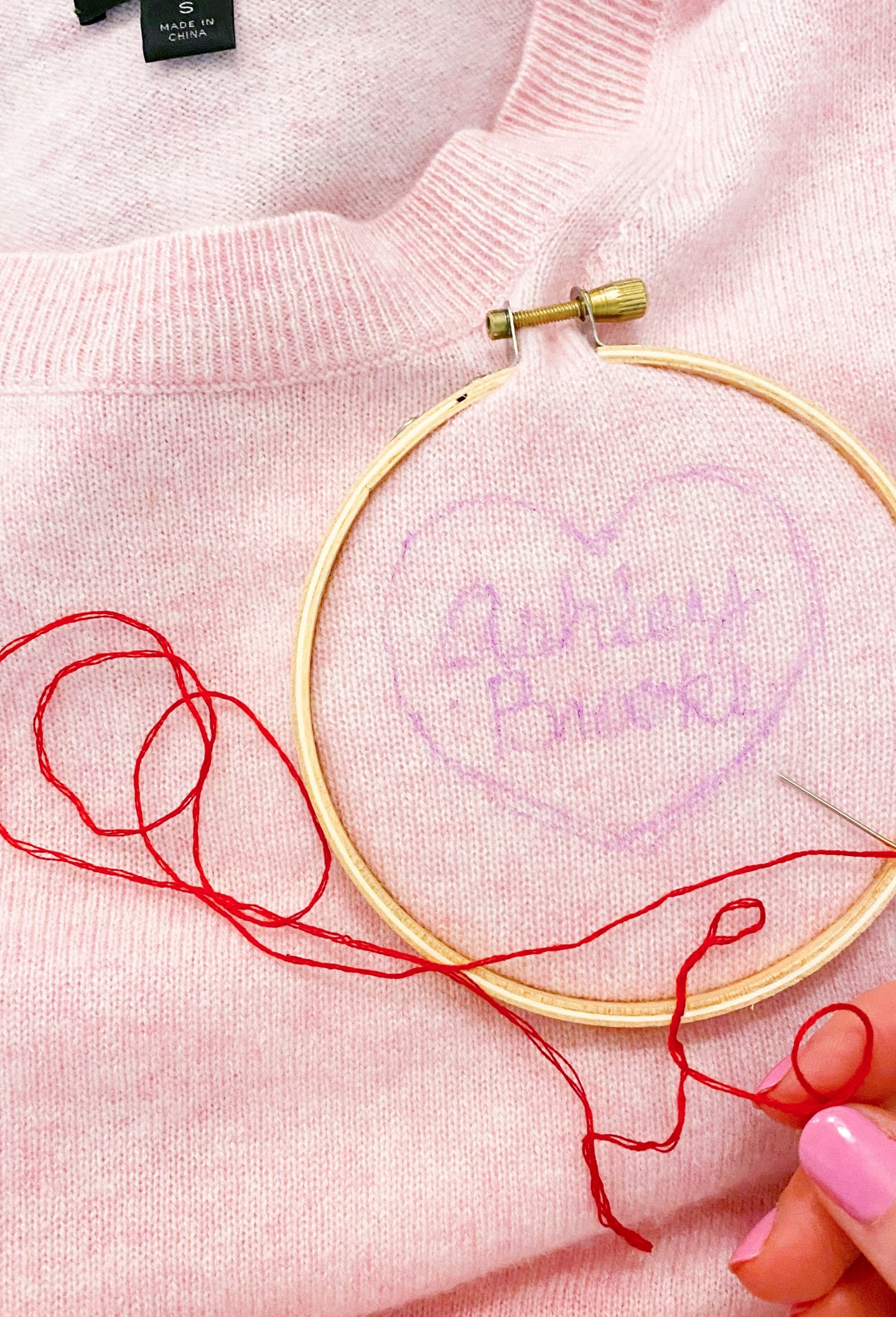 Embroidering a sweater and using invisible ink to trace the design