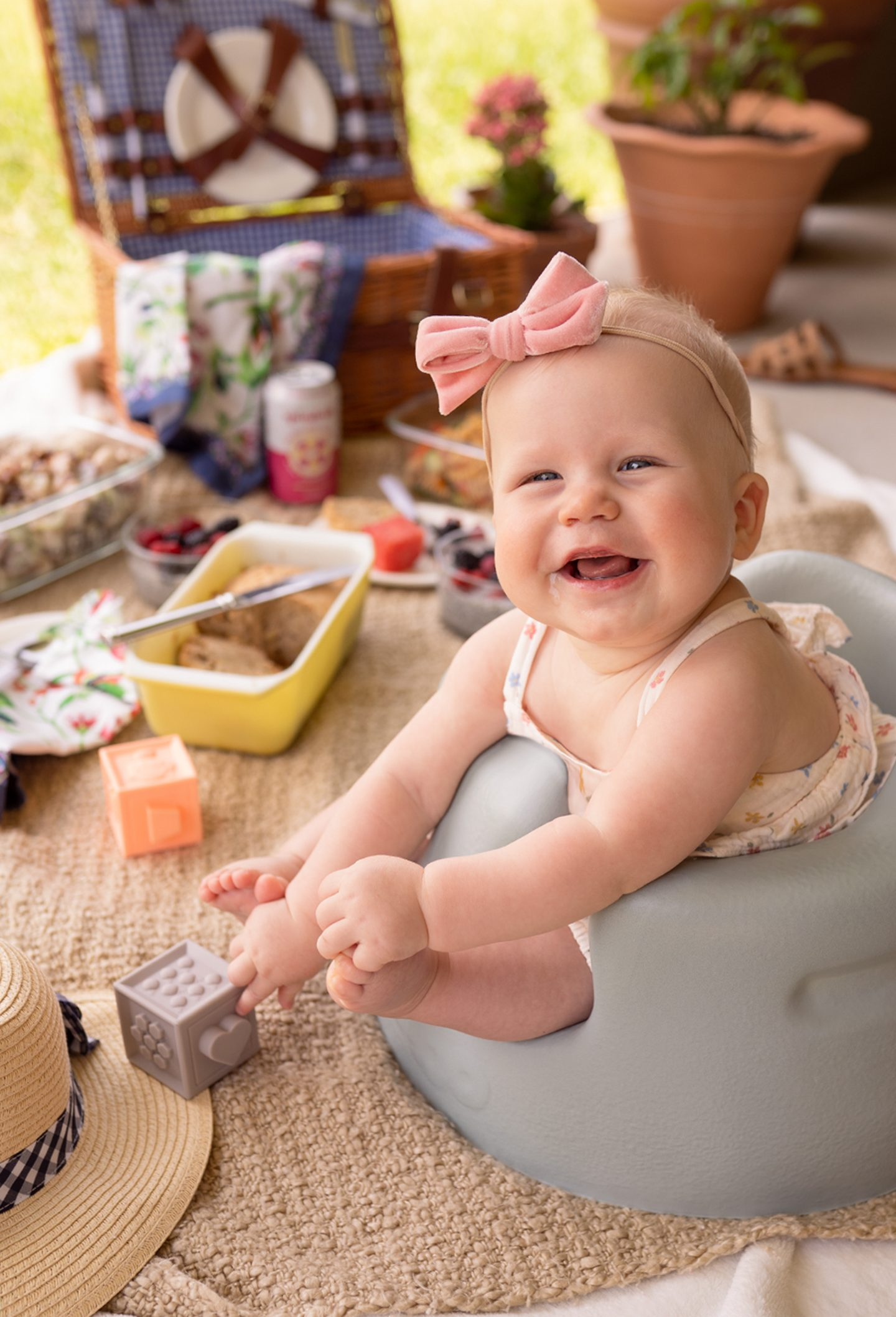 baby with headband smiling