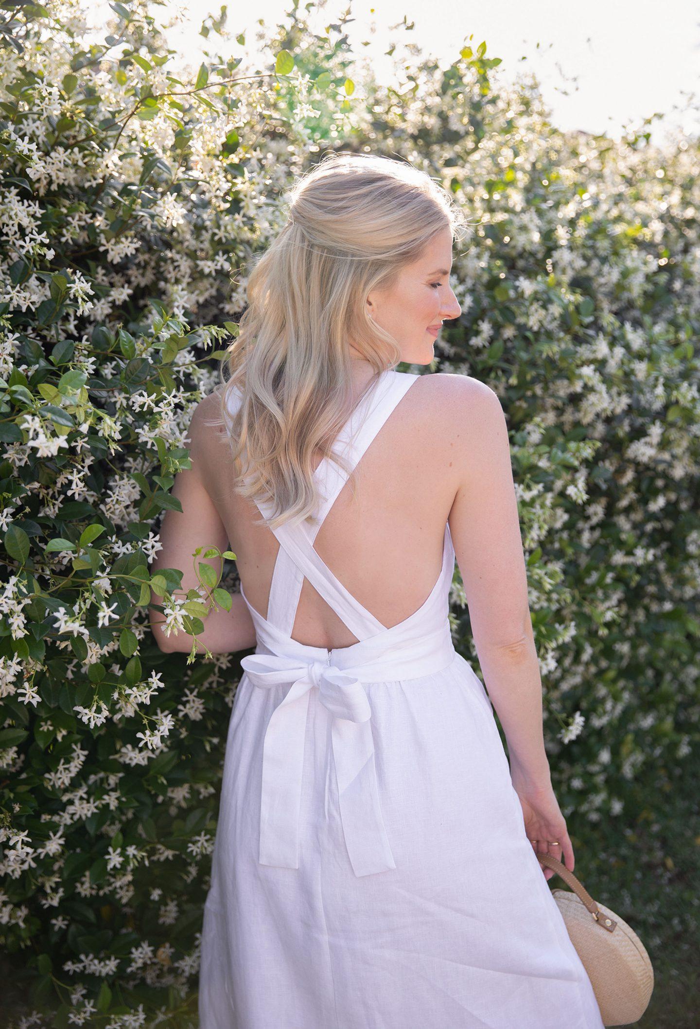 Ashley Brooke Wearing Backless Dress near a Jasmine Bloom