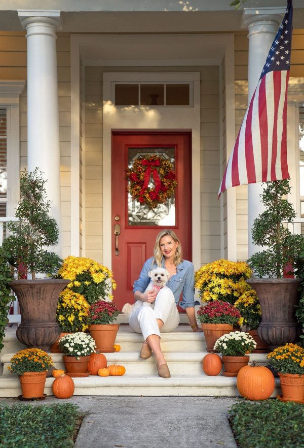 Ashley Brooke sitting on Fall Decorated Front Porch